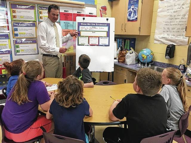 Bryan Eyink received the Celebrate Teaching Distinguished Educator Award from Battelle for Kids during a conference in Columbus on June 8.