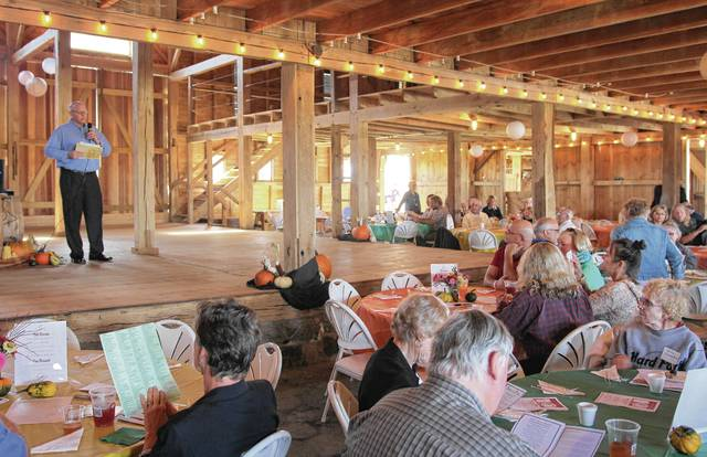 Paul Waldsmith, CEO of the Champaign Family YMCA, will be one of the presenters at the Oct. 8 State of the Plate local food dinner. He's pictured here emceeing the event two years ago in the Pretty Prairie barn, site of this year's dinner.