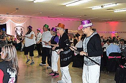 The Struttin Puttin on the Ritz Ladies entertain with a line dance during Fashions to a Tea.