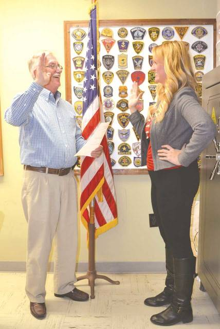 Mechanicsburg Mayor Greg Kimball swears in new council member Lyndsey Murphy at the meeting on Monday.